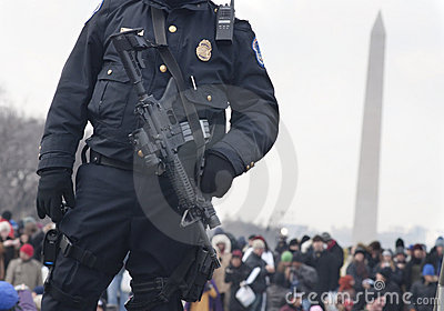 Police with M4 rifle guards crowd on National Mall Editorial Photography