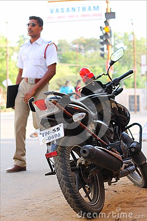 Police man and his bike Editorial Photo