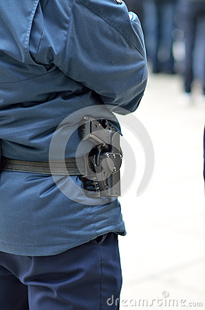 Police officer with gun in holster