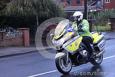 Police motorbike escort for cycle race Editorial Stock Photo