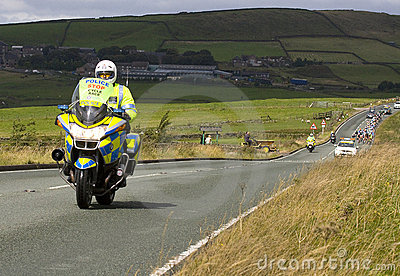 Police Motorcyclist on Tour of Britain Route Editorial Photography