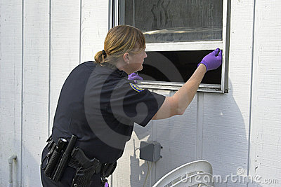 Police officer dusting prints