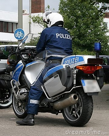 Police Officer with his Motorcycle