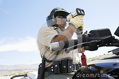 Police Officer Looking Through Radar Gun
