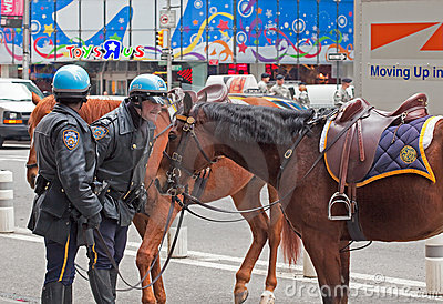 Police Officer scolds his misbehaving horse. Editorial Image