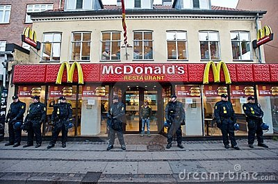 Police Officers Guarding a McDonald s in Denmark Editorial Stock Image