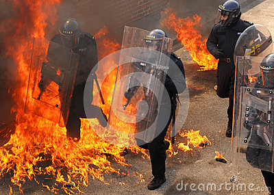 Police officers into the inferno Editorial Photography