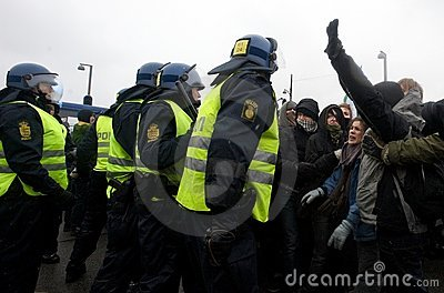 Police Officers Moving Against a Crowd