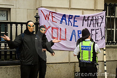 Police officers question  alien  marchers Editorial Stock Photo