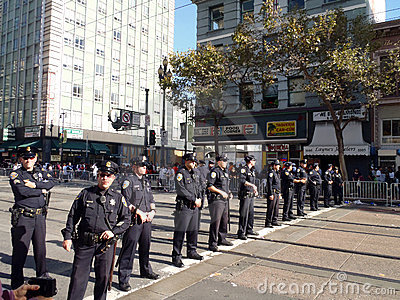 Police officers stand in line across market street Editorial Photo