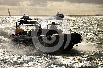 Police patrol RIB at speed Editorial Stock Image