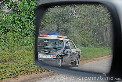 Police In Rear View Mirror Stock Photography Image 10703082