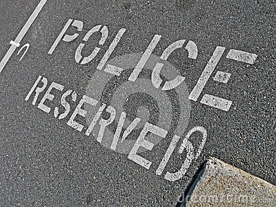 Police reserved as text on asphalt, security,