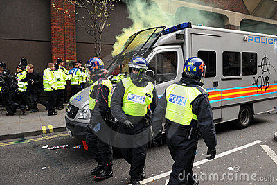 Police under Attack during a Riot in London Editorial Stock Photo