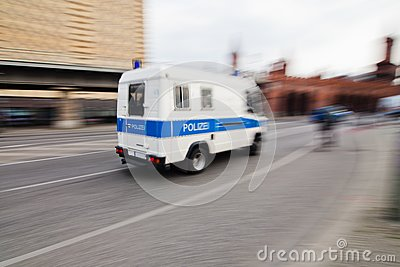 Police van in motion