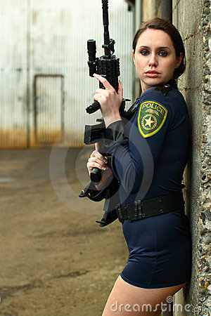 Police woman with assault rifle