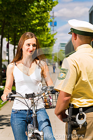 Police - woman on bicycle with police officer