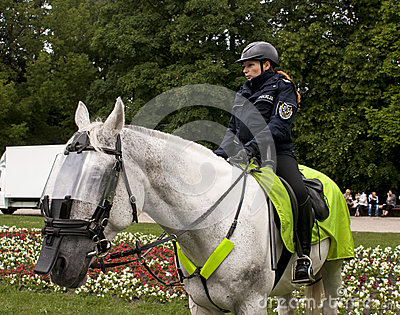 Police woman on horseback Editorial Stock Image