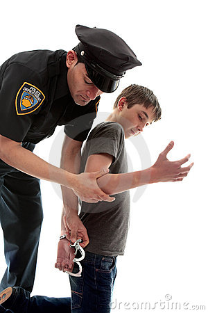 Policeman arresting teen criminal