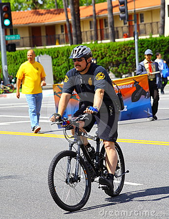 Policeman on Bike Editorial Image