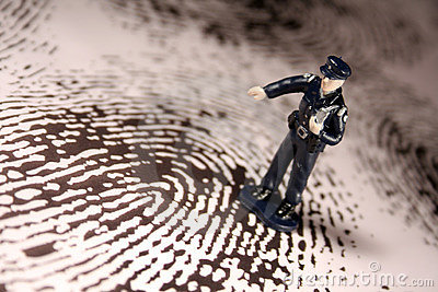 Policeman on giant fingerprint