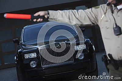 Policeman Holding Hand Baton To Stop Car