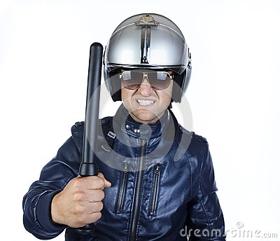 Policeman is holding a stick