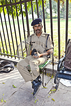 Policeman pays attention in the Red Fort to protects visitors Editorial Photography