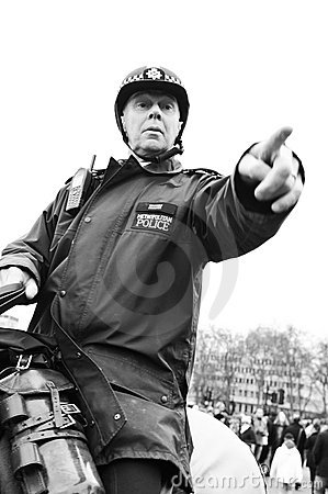 Policeman pointing Editorial Photography