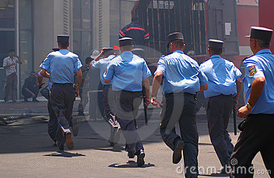 Policemen with batons