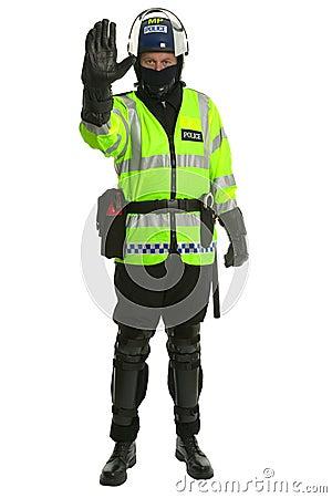 Policier dans le tenue anti-émeute - arrêt