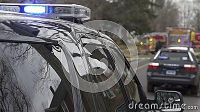 Polisbil nära en brottsplats (5 av 5)