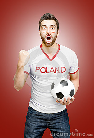 Free Polish Fan Holding A Soccer Ball Celebrates On Red Background Stock Image - 55537581