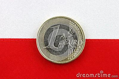Polish flag with one Euro coin.