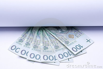 Polish money zloty, banknotes under roll of paper