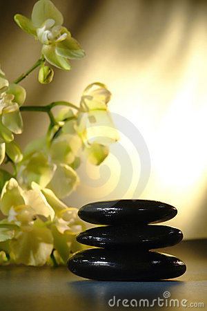 Polished Hot Massage Stones Cairn and Orchids