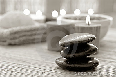 Polished Stone Cairn and Candles Burning in a Spa