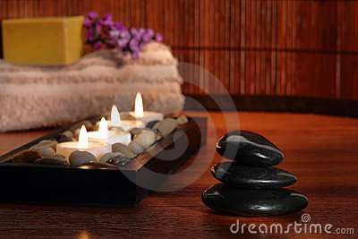 Polished Stone Cairn and Candles in Relaxation Spa