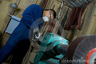 Polishing metal in workshop