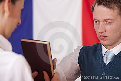 Politician swearing on the bible