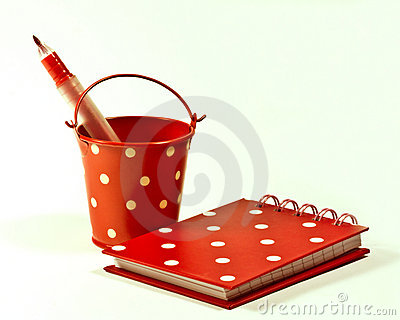 Polka dot bucket and notebook