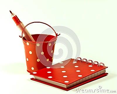 Polka dot bucket and notebook