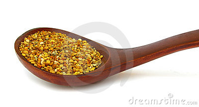 Pollen granules in wooden spoon