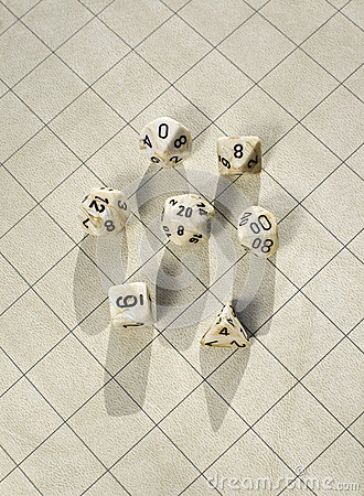 Polyhedral dice on blank roleplay game grid
