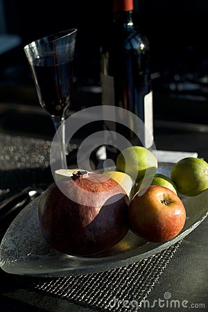 red wine glass and bottle with pomegranate