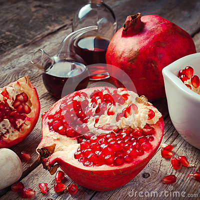 Free Pomegranate And Bottles Of Essence Or Tincture Royalty Free Stock Photography - 45354487