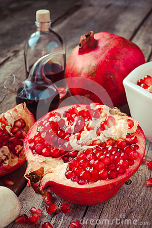 Free Pomegranate And Bottles Of Essence Or Tincture On Table Stock Images - 45355044