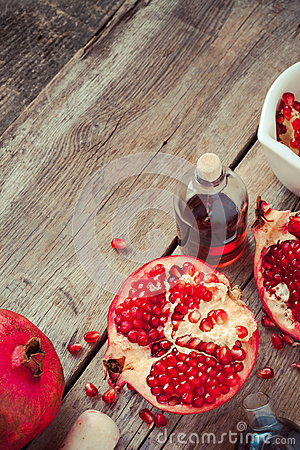 Free Pomegranate And Bottles Of Essence Or Tincture, Top View Royalty Free Stock Photography - 45354497