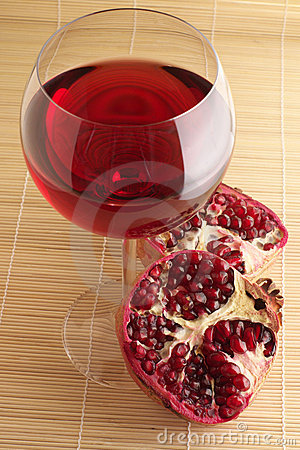Pomegranate and glass of red wine.