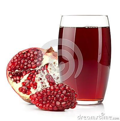 Pomegranate juice in a glass and ripe pomegranate